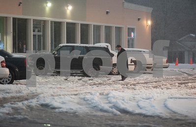 photo by Sarah A. Miller/ Tyler Morning Telegraph  A man stops at a gas station at the corner of Bow Street and Palace Ave. in the snow in Tyler Sunday night.