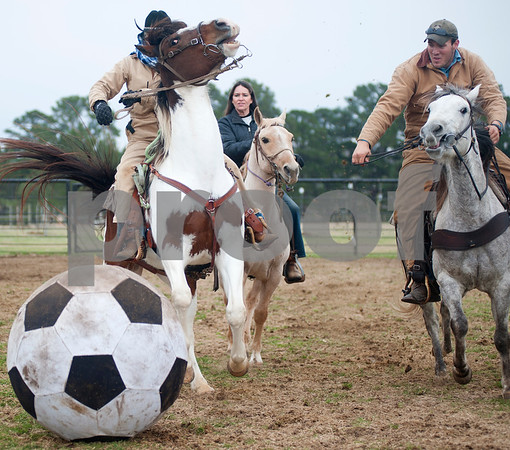 photo by Sarah A. Miller/Tyler Morning Telegraph  Brenda Jones of Maydelle, Kathy Hawkins of Diana and Matt McKeethan of Bullard race for possession of the ball during a game of Cowboy Mounted Soccer at the 1836 Chuckwagon Race Festival held at Diamond B Ranch in Neches, Texas Wednesday. The event celebrates Texas Independence Day Weekend sanctioned chuckwagon races March 7-9 and camping and other events throughout the week such as concerts, trail rides, a mounted shooting clinic and a dutch oven cooking class.