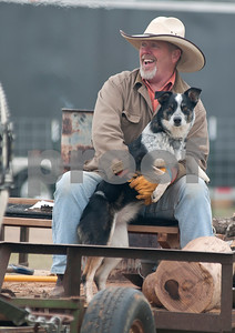 photo by Sarah A. Miller/Tyler Morning Telegraph  John Stone of Moulton, Ala. holds his dog Savannah as he rides on a wagon at the 1836 Chuckwagon Race Festival held at Diamond B Ranch in Neches, Texas Wednesday. The event celebrates Texas Independence Day Weekend sanctioned chuckwagon races March 7-9 and camping and other events throughout the week such as concerts, trail rides, a mounted shooting clinic and a dutch oven cooking class.