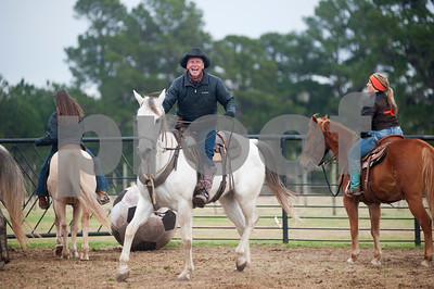 photo by Sarah A. Miller/Tyler Morning Telegraph   Donald Hawkins of Diana smiles after his team scored a goal in Cowboy Mounted Soccer at the 1836 Chuckwagon Race Festival held at Diamond B Ranch in Neches, Texas Wednesday. The event celebrates Texas Independence Day Weekend sanctioned chuckwagon races March 7-9 and camping and other events throughout the week such as concerts, trail rides, a mounted shooting clinic and a dutch oven cooking class.