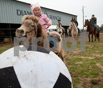 photo by Sarah A. Miller/Tyler Morning Telegraph  Piper Jones, 4, of Troup, learns how to play Cowboy Mounted Soccer on her pony Cassy at the 1836 Chuckwagon Race Festival held at Diamond B Ranch in Neches, Texas Wednesday. The event celebrates Texas Independence Day Weekend sanctioned chuckwagon races March 7-9 and camping and other events throughout the week such as concerts, trail rides, a mounted shooting clinic and a dutch oven cooking class.