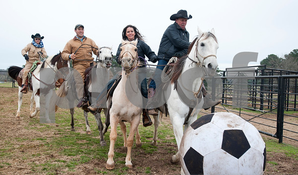 photo by Sarah A. Miller/Tyler Morning Telegraph  From left, Brenda Jones of Maydelle, Matt McKeethan of Bullard, Kathy Hawkins of Diana and Donald Hawkins of Diana play in a male versus female game of Cowboy Mounted Soccer at the 1836 Chuckwagon Race Festival held at Diamond B Ranch in Neches, Texas Wednesday. The event celebrates Texas Independence Day Weekend sanctioned chuckwagon races March 7-9 and camping and other events throughout the week such as concerts, trail rides, a mounted shooting clinic and a dutch oven cooking class.