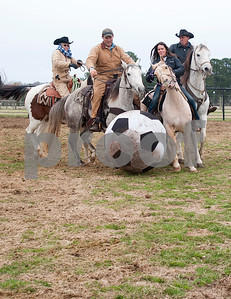 photo by Sarah A. Miller/Tyler Morning Telegraph  Brenda Jones of Maydelle, Matt McKeethan of Bullard, Kathy Hawkins of Diana and Donald Hawkins of Diana play in a male versus female game of Cowboy Mounted Soccer at the 1836 Chuckwagon Race Festival held at Diamond B Ranch in Neches, Texas Wednesday. The event celebrates Texas Independence Day Weekend sanctioned chuckwagon races March 7-9 and camping and other events throughout the week such as concerts, trail rides, a mounted shooting clinic and a dutch oven cooking class.