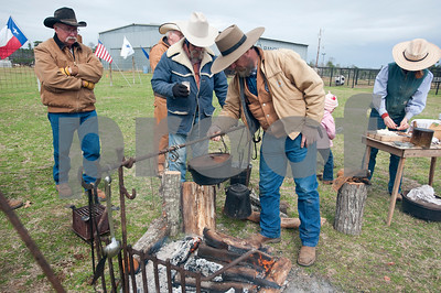 photo by Sarah A. Miller/Tyler Morning Telegraph  A dutch oven cooks beans over a camp fire at the 1836 Chuckwagon Race Festival held at Diamond B Ranch in Neches, Texas Wednesday. The event celebrates Texas Independence Day Weekend sanctioned chuckwagon races March 7-9 and camping and other events throughout the week such as concerts, trail rides, a mounted shooting clinic and a dutch oven cooking class.