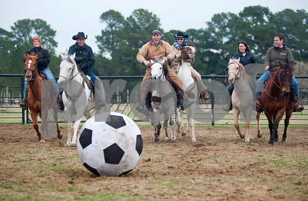 photo by Sarah A. Miller/Tyler Morning Telegraph  Riders race for possession of the ball during a game of Cowboy Mounted Soccer at the 1836 Chuckwagon Race Festival held at Diamond B Ranch in Neches, Texas Wednesday. The event celebrates Texas Independence Day Weekend sanctioned chuckwagon races March 7-9 and other events throughout the week such as concerts, trail rides, a mounted shooting clinic and a dutch oven cooking class. Pictured left to right: Jena Hawkins of Diana, Donald Hawkins of Diana, Matt McKeethan of Bullard, Brenda Jones of Maydelle, Kathy Hawkins of Diana and Justin Reeves of Longview.