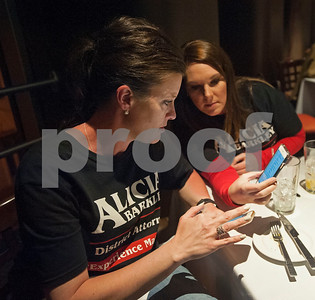 Nancy Parker, left, a legal assistant for Smith County District Attorney candidate Alicia Barkley, pulls up election results on her phone during Barkley's election night watch party held at Jack Ryan's in downtown Tyler on Tuesday March 6, 2018.  (Sarah A. Miller/Tyler Morning Telegraph)