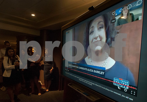 Smith County District Attorney candidate Alicia Barkley stands next to television reporters as she watches an interview of herself from her election night watch party while at her party held at Jack Ryan's in downtown Tyler on Tuesday March 6, 2018.  (Sarah A. Miller/Tyler Morning Telegraph)