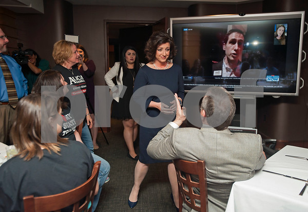 Smith County District Attorney candidate Alicia Barkley talks with her supporters as her competitor, Jacob Putman, is seen on a television screen being interviewed during her election night watch party held at Jack Ryan's in downtown Tyler on Tuesday March 6, 2018.  (Sarah A. Miller/Tyler Morning Telegraph)