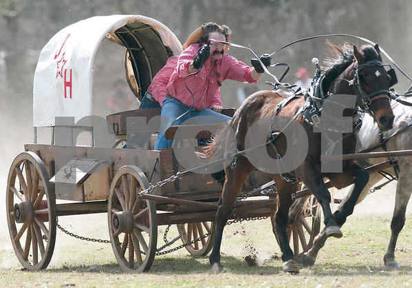 photo by Sarah A. Miller/Tyler Morning Telegraph  Team J Star H from Bee Branch, Ark. races in the classic division race at the 1836 Chuckwagon Race in Neches, Texas Friday March 7, 2014. The 1836 Chuckwagon Race at Diamond B Ranch is a week long celebration of western culture centering around Texas Independence Day weekend. The race is sanctioned by the National Championship Chuckwagon Race and Texas Chuckwagon Race Association. Races continue Saturday and Sunday. The classic chuckwagon must weigh 1000 pounds.