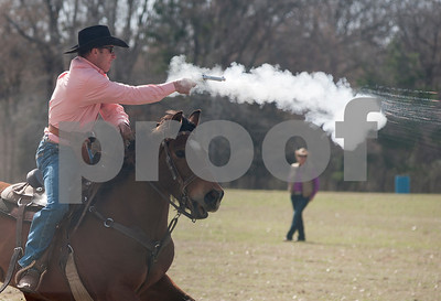 photo by Sarah A. Miller/Tyler Morning Telegraph  Zane Runyan of Lott, Texas shoots a blank cartridge at a balloon target with a .45 pistol during the Cowboy Mounted Shooting event at the 1836 Chuckwagon Race in Neches, Texas Friday March 7, 2014. The 1836 Chuckwagon Race at Diamond B Ranch is a week long celebration of western culture centering around Texas Independence Day weekend. Cowboy Mounted Shooting is a timed event where competitors use two pistols while riding a horse or mule through balloon targets. Each balloon missed is a five second penalty.
