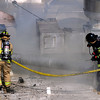 Fire fighters work to contain a structure fire at 14th and Pearl Street in Boulder, Colorado March 9, 2011.  CAMERA/Mark Leffingwell