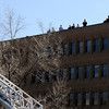 A crowd gathers to watch fire fighters work to control the structure fire at 14th and Pearl Street in Boulder, Colorado March 9, 2011.  CAMERA/Phil McMichael