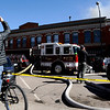 Lonny Frye takes photos with his camera phone of the structure fire at 14th and Pearl Street in Boulder, Colorado March 9, 2011.  CAMERA/Phil McMichael
