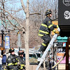 A fire fighter climbs up a ladder  to control the structure fire at 14th and Pearl Street in Boulder, Colorado March 9, 2011.  CAMERA/Phil McMichael