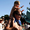 "Hazel Fernley, 3, of Oak Creek, Colo., claps for the bands while riding on the shoulders of her father, Adam Fernley, on Saturday, July 30, during the 39th annual RockyGrass Festival at The Planet Bluegrass Ranch in Lyons. For more photos and a video of the festival go to  <a href=""http://www.dailycamera.com"">http://www.dailycamera.com</a><br /> Jeremy Papasso/ Camera"