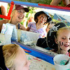 """Ella House, 7, of Charlottesville, Virginia, right, looks in the mirror at her painted face on Saturday, July 30, during the 39th annual RockyGrass Festival at The Planet Bluegrass Ranch in Lyons. For more photos and a video of the festival go to  <a href=""""http://www.dailycamera.com"""">http://www.dailycamera.com</a><br /> Jeremy Papasso/ Camera"""