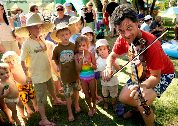 "Colin O'Brien, of Milwaukee, plays some bluegrass for the kids on Saturday, July 30, during the 39th annual RockyGrass Festival at The Planet Bluegrass Ranch in Lyons. For more photos and a video of the festival go to  <a href=""http://www.dailycamera.com"">http://www.dailycamera.com</a><br /> Jeremy Papasso/ Camera"