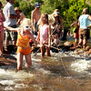 "Sedona Clifford, 7, of Longmont, in orange swimsuit, tries to catch a fish on Saturday, July 30, during the 39th annual RockyGrass Festival at The Planet Bluegrass Ranch in Lyons. For more photos and a video of the festival go to  <a href=""http://www.dailycamera.com"">http://www.dailycamera.com</a><br /> Jeremy Papasso/ Camera"