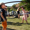"Benton House, 5, of Charlottesville, Virginia, left, plays with a hoola-hoop on Saturday, July 30, during the 39th annual RockyGrass Festival at The Planet Bluegrass Ranch in Lyons. For more photos and a video of the festival go to  <a href=""http://www.dailycamera.com"">http://www.dailycamera.com</a><br /> Jeremy Papasso/ Camera"