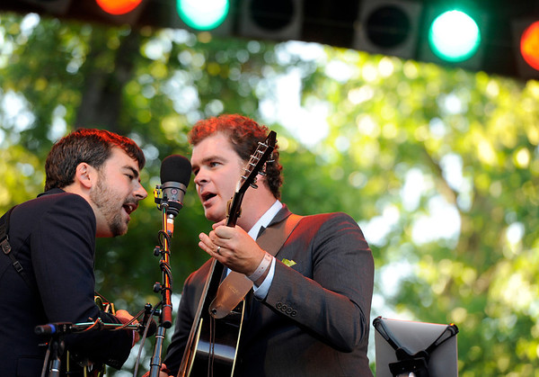 "Steep Canyon Rangers band members Woody Platt, left, and Nicky Sanders sing together while playing with Steve Martin on Saturday, July 30, during the 39th annual RockyGrass Festival at The Planet Bluegrass Ranch in Lyons. For more photos and a video of the festival go to  <a href=""http://www.dailycamera.com"">http://www.dailycamera.com</a><br /> Jeremy Papasso/ Camera"