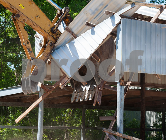 A structure is torn down during Hiway 80 Rescue Mission's Demo Day event at their Triumph Village site on Highway 64 West in Tyler on Tuesday April 10, 2018.  (Sarah A. Miller/Tyler Morning Telegraph)