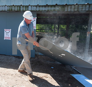 John Murphy takes a sledgehammer to a wall of a building that was torn down on Tuesday April 19, 2018 as part of the Demo Day event held by Hiway 80 Rescue Mission. Hiway 80 Rescue Mission invited special guests, along with a construction crew, to help demolish a structure to make room for new buildings on their Triumph Village site, located at 12781 Highway 64 West in Tyler.   (Sarah A. Miller/Tyler Morning Telegraph)