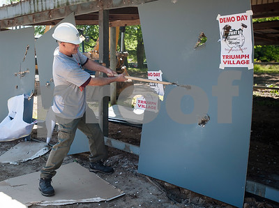 A man takes a sledgehammer to a wall of a building that was torn down on Tuesday April 19, 2018 as part of the Demo Day event held by Hiway 80 Rescue Mission. Hiway 80 Rescue Mission invited special guests, along with a construction crew, to help demolish a structure to make room for new buildings on their Triumph Village site, located at 12781 Highway 64 West in Tyler.   (Sarah A. Miller/Tyler Morning Telegraph)