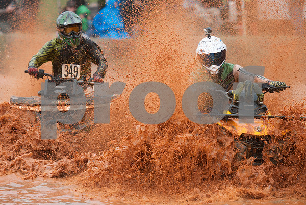 Two riders compete in the Arctic Cat Mudda Cross event Friday afternoon April 1, 2016 at the High Lifter ATV Mud Nationals presented by Polaris at Mud Creek Off-Road Park in Jacksonville.  (Sarah A. Miller/Tyler Morning Telegraph)