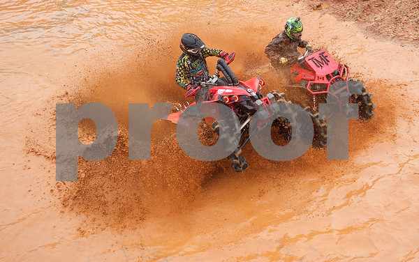 Brad Edwards and Bill Ford compete in the Arctic Cat Mudda Cross event Friday afternoon April 1, 2016 at the High Lifter ATV Mud Nationals presented by Polaris at Mud Creek Off-Road Park in Jacksonville.  (Sarah A. Miller/Tyler Morning Telegraph)