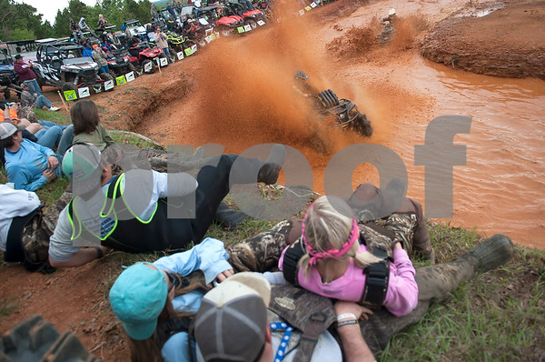 Spectators lean back as competitors splash mud high into the air during the Arctic Cat Mudda Cross event Friday afternoon April 1, 2016 at the High Lifter ATV Mud Nationals presented by Polaris at Mud Creek Off-Road Park in Jacksonville.  (Sarah A. Miller/Tyler Morning Telegraph)