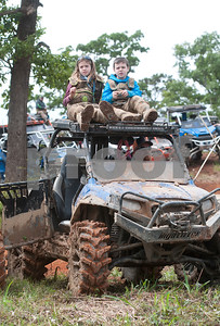 Braelyn Fox, 9, and Daniel Fox, 8, of Bossier City, Louisiana, sit on top of their father's ATV to watch the Arctic Cat Mudda Cross event Friday afternoon April 1, 2016 at the High Lifter ATV Mud Nationals presented by Polaris at Mud Creek Off-Road Park in Jacksonville.  (Sarah A. Miller/Tyler Morning Telegraph)