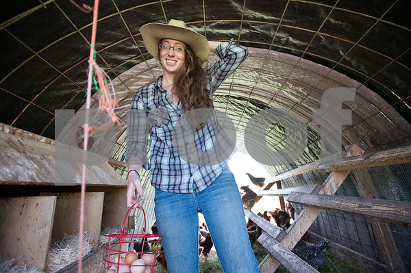 photo by Sarah A. Miller/Tyler Morning Telegraph  Alissa Rhodes, 24, operator of Lonesome Lady Ranch, collects eggs from her hens Tuesday April 7, 2015. Lonesome Lady Ranch is a local family farm located in the New Harmony community just outside of Tyler. The farm raises poultry, eggs, lamb, and commercial cattle. The animals are pasture raised using rotational grazing management and fed diets free of added growth hormones, drugs, or genetically modified food used by the commercial food industry. Rhodes sells her eggs weekly at the Rose City Farmers Market held at the Juls parking lot Saturdays in Tyler.