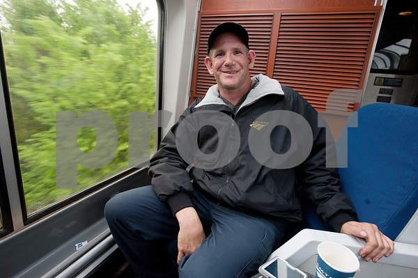 "photo by Sarah A. Miller/Tyler Morning Telegraph  James Kenny, 43, of Denver, Colorado sits in the Sightseer Lounge car of an Amtrak train on the Texas Eagle route passing between the Mineola and Dallas stations Thursday April 9, 2015. Kenny says he has been riding Amtrak routes for two years straight by buying 45 day passes and he started this leg of his journey in Chicago. ""When I was a kid I always wanted to work for Amtrak. I told my finance we can't get married because Amtrak is my first love,"" Kenny said continuing, ""I'm going to take the Amtrak 'till the day I die."""