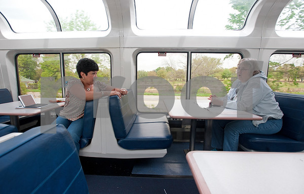 photo by Sarah A. Miller/Tyler Morning Telegraph  Ana Melton of Holly Lake Ranch, Texas talks with first time rider Leeann Saunders on the Texas Eagle route on the Amtrak train for the first time Thursday April 9, 2015. Saunders was traveling from Cleveland, Ohio to Tuscan, Arizona. Melton rides the Amtrak every week commuting from her home to her job in Fort Worth. The Amtrak train offers coach cars, a lounge car, a sleeper car and dining car along this route.