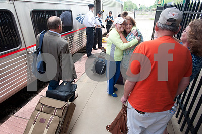 photo by Sarah A. Miller/Tyler Morning Telegraph  Candi Branin of Tyler, left, hugs long time friend Candy Diebold, right, as she arrives at the Mineola Amtrak station for a visit from Missouri Thursday April 9, 2015. The Amtrak train offers coach cars, a lounge car, a sleeper car and dining car.