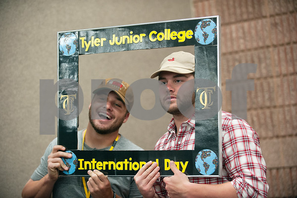 photo by Sarah A. Miller/Tyler Morning Telegraph  Tyler Junior College students Zane Ancell and Landon Brune attend the school's 25th annual International Day,  Tuesday April 14 in the Apache Rooms of Rogers Student Center. The event featured musical performances, free food, informational booths about various countries, and information on applying for a passport.