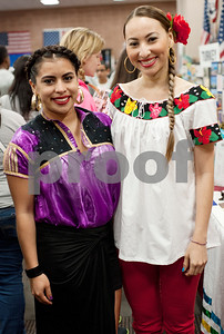 photo by Sarah A. Miller/Tyler Morning Telegraph  Tyler Junior College international students Arantxa Midalgo of Mexico and Yanitoa Davila Castillo of Costa Rica wear clothing representing their countries at the school's 25th annual International Day,  Tuesday April 14 in the Apache Rooms of Rogers Student Center. The event featured musical performances, free food, informational booths about various countries, and information on applying for a passport.