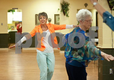 photo by Sarah A. Miller/Tyler Morning Telegraph  Barbara Farnum of Tyler, left, and Dee Kirkpatrick of Tyler, right, dance during clogging practice Tuesday April 14, 2015 at the Tyler Senior Center.