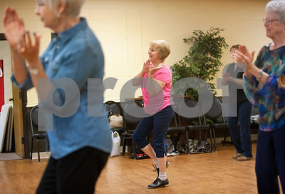 photo by Sarah A. Miller/Tyler Morning Telegraph  Pam Bennett of Lindale, center, dances during clogging practice Tuesday April 14, 2015 at the Tyler Senior Center.