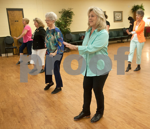 photo by Sarah A. Miller/Tyler Morning Telegraph  Alice Null of Red Springs, center, dances during clogging practice Tuesday April 14, 2015 at the Tyler Senior Center.
