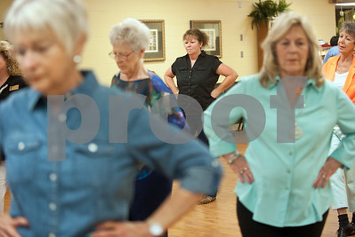 photo by Sarah A. Miller/Tyler Morning Telegraph  Barbara Nix of Tyler, center, dances during clogging practice Tuesday April 14, 2015 at the Tyler Senior Center.
