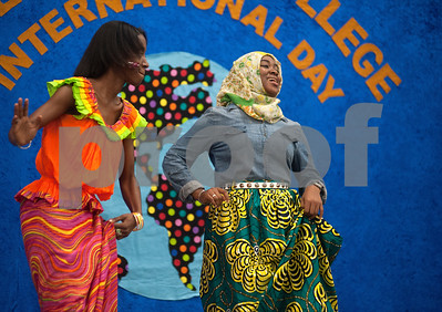 photo by Sarah A. Miller/Tyler Morning Telegraph  TJC students Mary Mendy and Awa Njie perform a Ndagga dance from Gambia Tuesday at Tyler Junior College's International Day.