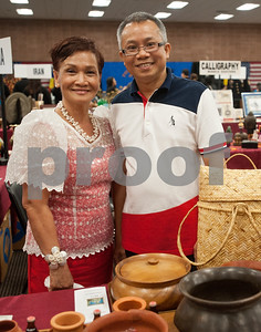 photo by Sarah A. Miller/Tyler Morning Telegraph  Sergia Santos and Kevin Santos stand at the booth for the Philippines at Tyler Junior College's International Day Tuesday.