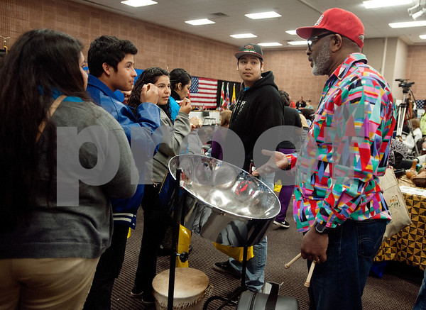 photo by Sarah A. Miller/Tyler Morning Telegraph  Tyler Junior College professor Arthur Smith talks to a group of John Tyler High School students at International Day Tuesday about the steel drum, an instrument from his native Trinidad and Tobago.