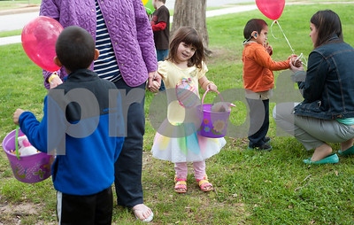 photo by Sarah A. Miller/Tyler Morning Telegraph  Avrie Maxwell, 6, of Tyler, holds her bucket as she searches for eggs during the third annual Lighthouse Easter Egg Hunt at Bergfeld Park Thursday afternoon. She is visually impaired. The event featured beeping eggs for blind children and jumbo sized eggs for visually impaired children. East Texas Lighthouse for the Blind, Texas Department of Assistive and Rehabilitative Services and Tyler Independent School District volunteers helped run the event. The Easter egg hunt was an opportunity for visually impaired children to improve their orientation and mobility, their recreation and leisure skills and social skills.
