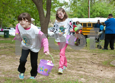 photo by Sarah A. Miller/Tyler Morning Telegraph  Sarah Hoag, 7, of Lindale and Kara White, 11, of Hideaway, run as they search for eggs during the third annual Lighthouse Easter Egg Hunt at Bergfeld Park Thursday afternoon. The event featured beeping eggs for blind children and jumbo sized eggs for visually impaired children. East Texas Lighthouse for the Blind, Texas Department of Assistive and Rehabilitative Services and Tyler Independent School District volunteers helped run the event. The Easter egg hunt was an opportunity for visually impaired children to improve their orientation and mobility, their recreation and leisure skills and social skills.