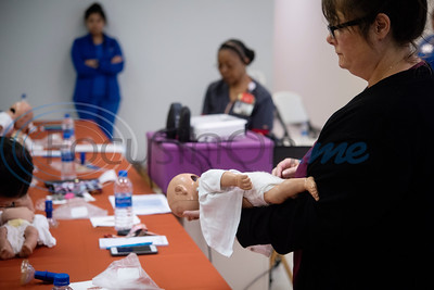 Expectant moms and new mothers from the Nurse-Family Partnership program through The University of Texas Health Science Center at Tyler take an infant CPR and choking class through a grant provided by the American College of Nurse-Midwives Foundation Thacher Community Grant.  Nurse-Family Partnership is a program that pairs first time mothers with home visits from a nurse to ensure a successful pregnancy.   (Sarah A. Miller/Tyler Morning Telegraph)