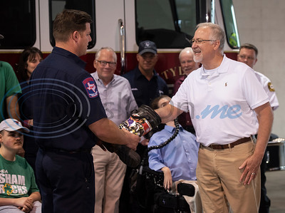 Firefighter James Branch receives the first Fill the Boot donation from Tyler Mayor Martin Heines during a press conference at Tyler Fire Station No. 7 announcing their kick-off to raise money for the Muscular Dystrophy Association on Wednesday April 17, 2019. The Tyler Fire Department's Fill the Boot campaign is aiming tp raise $70,000 for MDA.   (Sarah A. Miller/Tyler Morning Telegraph)