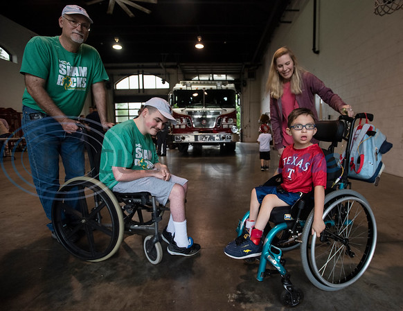 Gary Smith of Tyler and his son Mitchell Smith, 14, greet Evan Valle, 5, of Lindale, and his mother Tiffany Valle after a press conference at Tyler Fire Station No. 7 announcing their kick-off to raise money for the Muscular Dystrophy Association on Wednesday April 17, 2019. The Tyler Fire Department's Fill the Boot campaign is aiming tp raise $70,000 for MDA.   (Sarah A. Miller/Tyler Morning Telegraph)