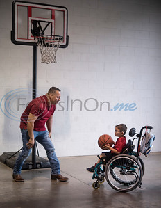Paulino Valle of Lindale plays basketball with his son Evan Valle, 5, after a press conference at Tyler Fire Station No. 7 announcing their kick-off to raise money for the Muscular Dystrophy Association on Wednesday April 17, 2019. The Tyler Fire Department's Fill the Boot campaign is aiming tp raise $70,000 for MDA.   (Sarah A. Miller/Tyler Morning Telegraph)